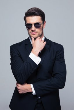 Trendy young businessman in sunglasses
