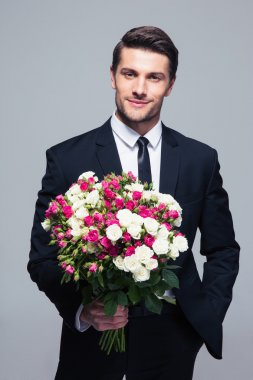 Businessman holding flowers