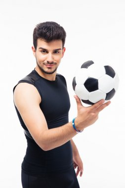 Happy soccer player holding ball
