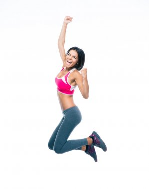 Smiling sporty woman jumping