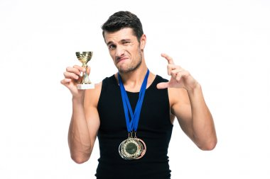 Sports man showing small winners cup