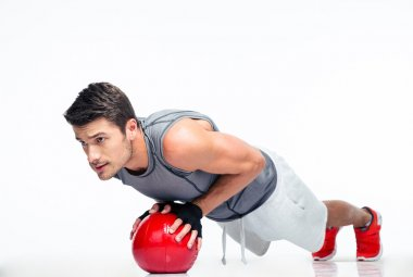 Sports man working out with fitness ball