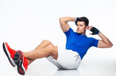 Sports man doing abdominal exercises