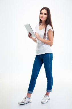 Smiling beautiful woman holding tablet computer
