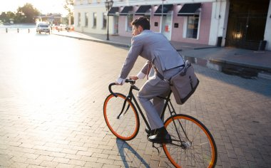 Businessman riding bicycle to work