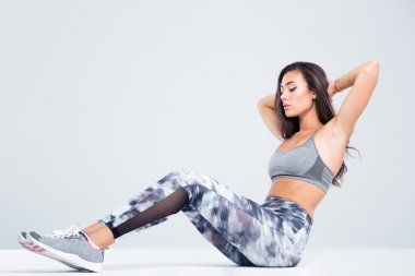 Portrait of a fitness woman doing abs exercises