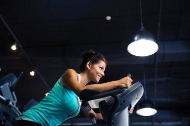 Woman workout on exercises machine