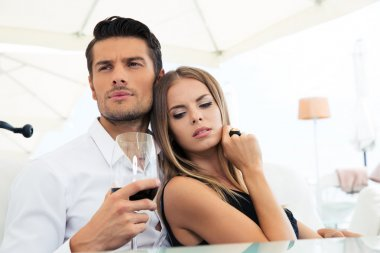 Couple sitting with glass of wine