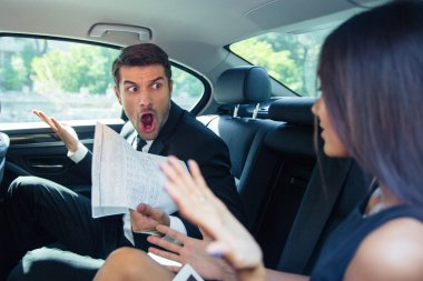 Man shouting on a woman in car