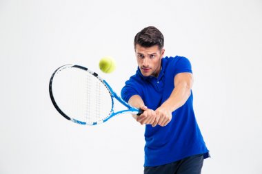 Portrait of a handsome man playing in tennis