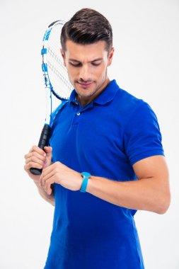 Tennis player looking on fitness activity