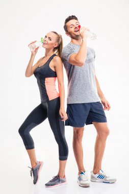 Full length portrait of a couple drinking water