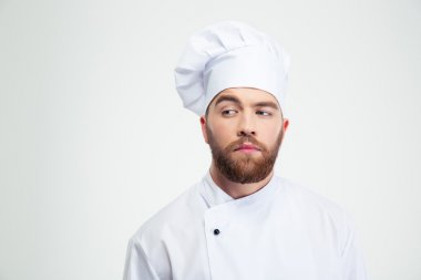 Portrait of a pensive male chef cook looking away