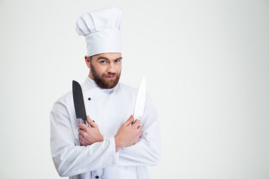 Male chef cook holding knifes