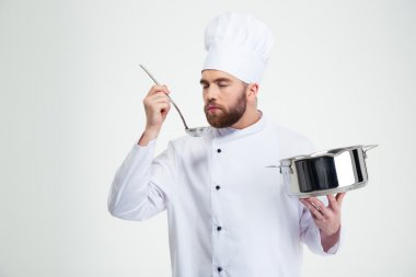 Male chef cook holding a saucepan and ladle