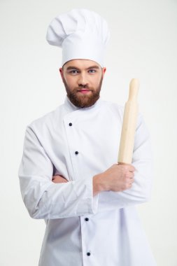 Male chef cook holding a rolling pin