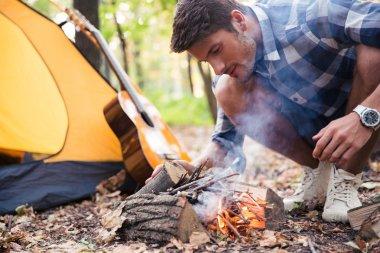 Man and bonfire
