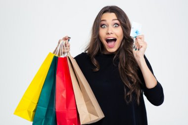 Woman holding shopping bags and bank card