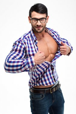 Handsome man in glasses unbuttoning shirt