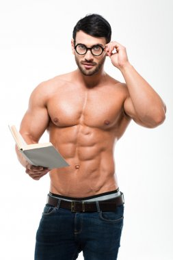 Muscular man in glasses holding book