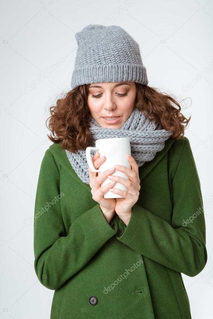 3792e25ae428 Woman in winter cloth holding cup with coffee — Stock Photo ...