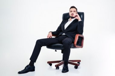 Assured confident business man with beard sitting in office chair