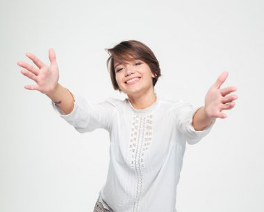 Happy charming woman with opened hands reaching towards the camera