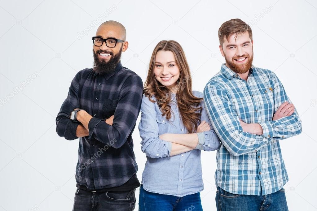 Multiethnic group of three confident smiling students