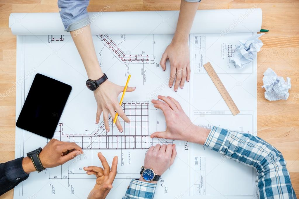 Group of achetects drawing blueprint together stock photo group of achetects drawing blueprint together stock photo malvernweather Gallery