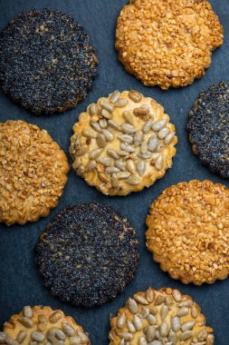 Healthy cookies with seeds, food background from above