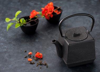Tea Asian background. Cast iron teapot and cup green tea.