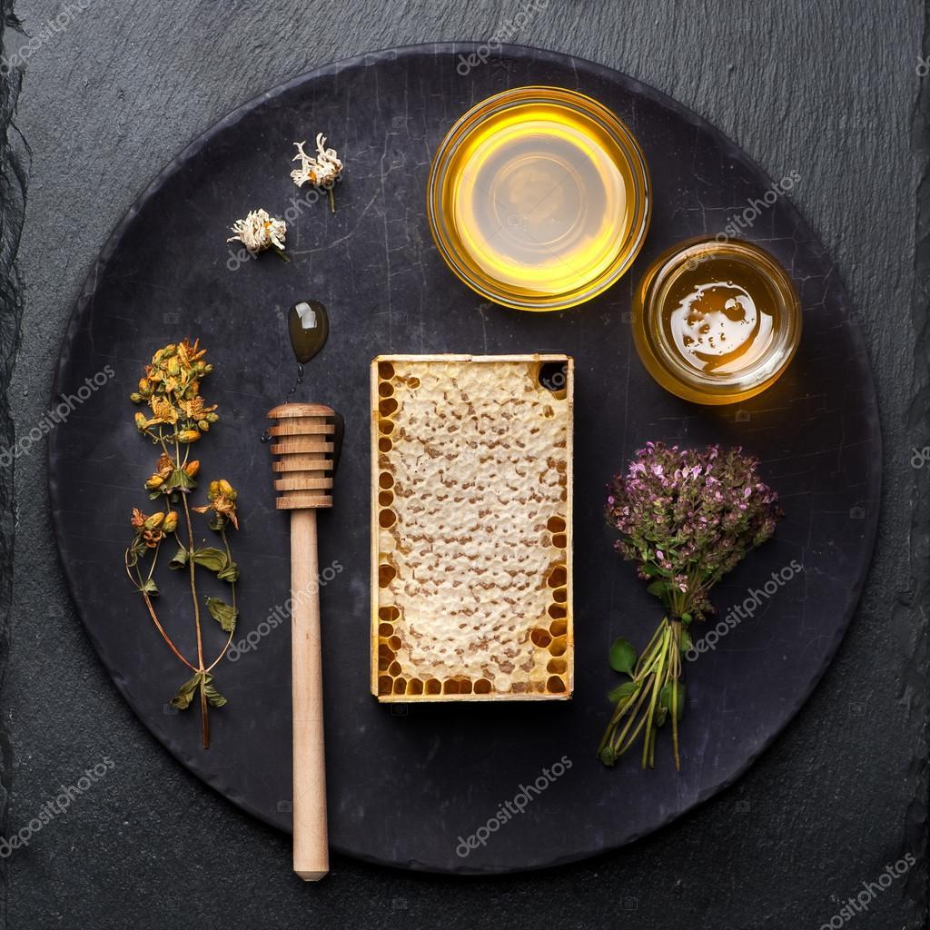 Honey comb on dark grunge background