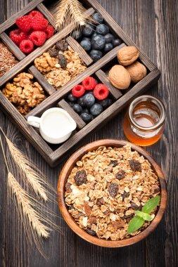 Granola muesli with berries, honey, nuts and milk. foods for breakfast