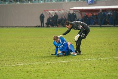 Goalkeeper helps injured player