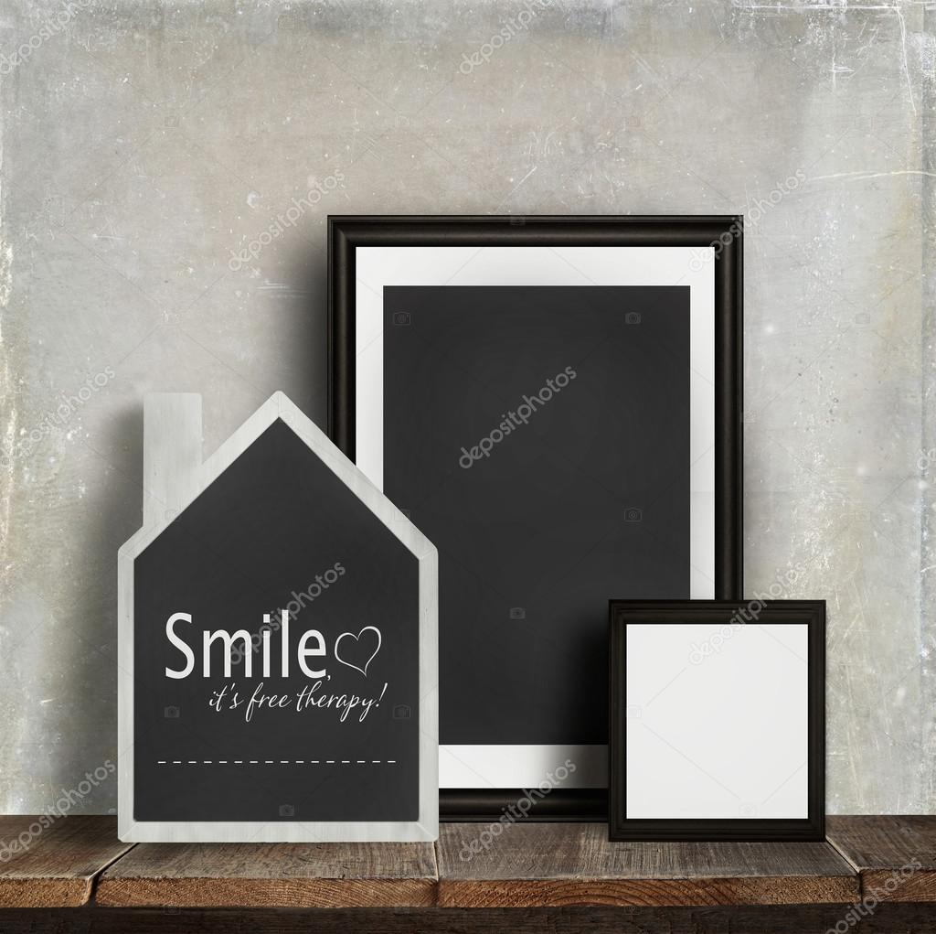 Chalkboard with quote and frames on table — Stock Photo © Sandralise ...