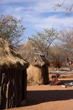 Himba woman in her village