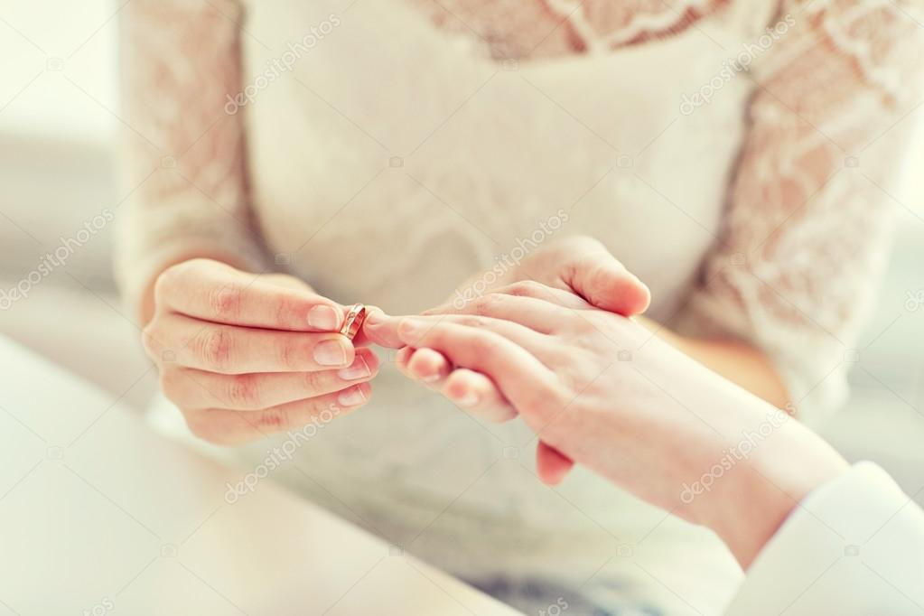 close up of lesbian couple hands with wedding ring Stock Photo