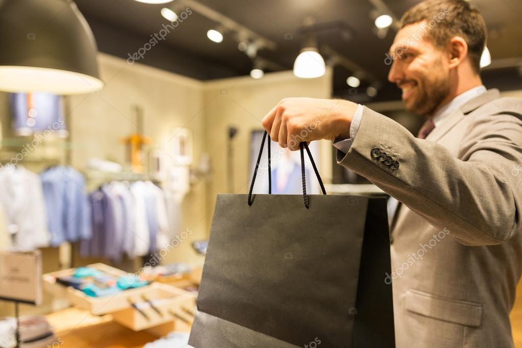 close up of man with shopping bags at store stock photo syda productions 111013484. Black Bedroom Furniture Sets. Home Design Ideas