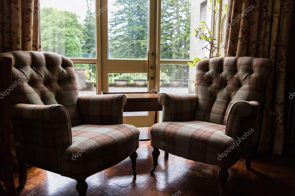 Close Up Of Vintage Armchairs And Table In Hotel Stock Photo