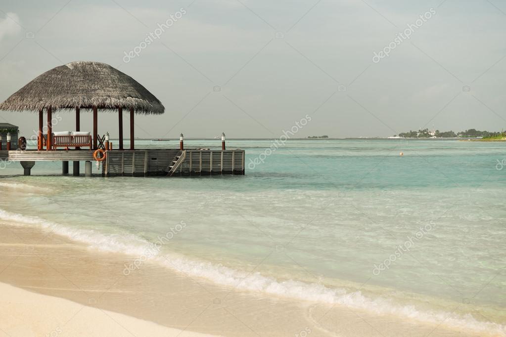 Patio O Terraza Con Toldo En La Orilla Del Mar Playa Foto