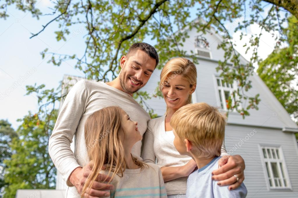 happy family in front of house outdoors stock photo syda productions 54320367. Black Bedroom Furniture Sets. Home Design Ideas