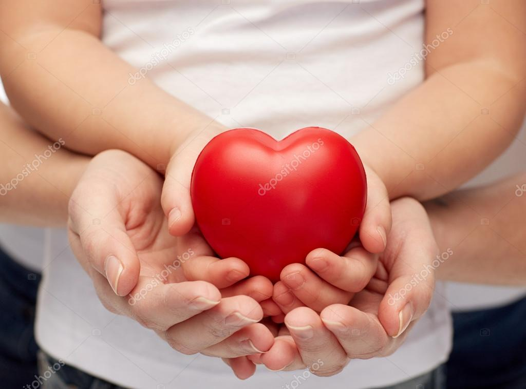 close up of woman and girl hands holding heart — Stock Photo ...