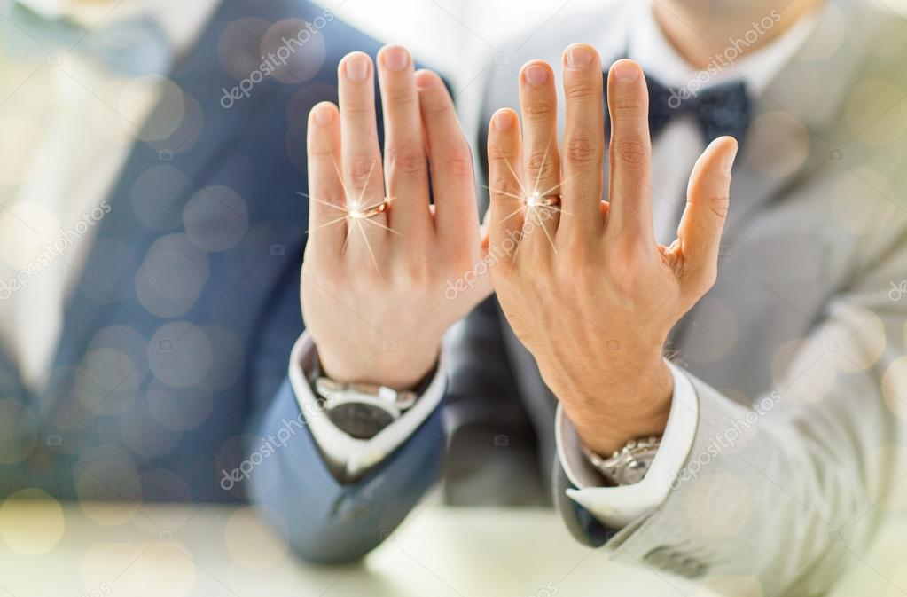 close up of male gay couple with wedding rings on Stock Photo