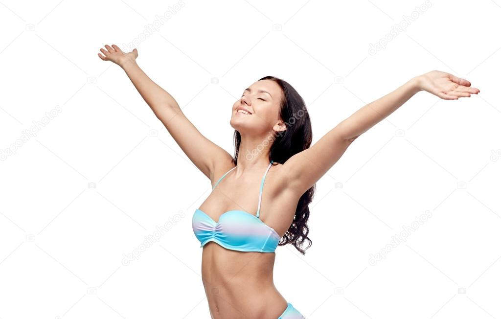 Nude and happy woman eating sugar cu