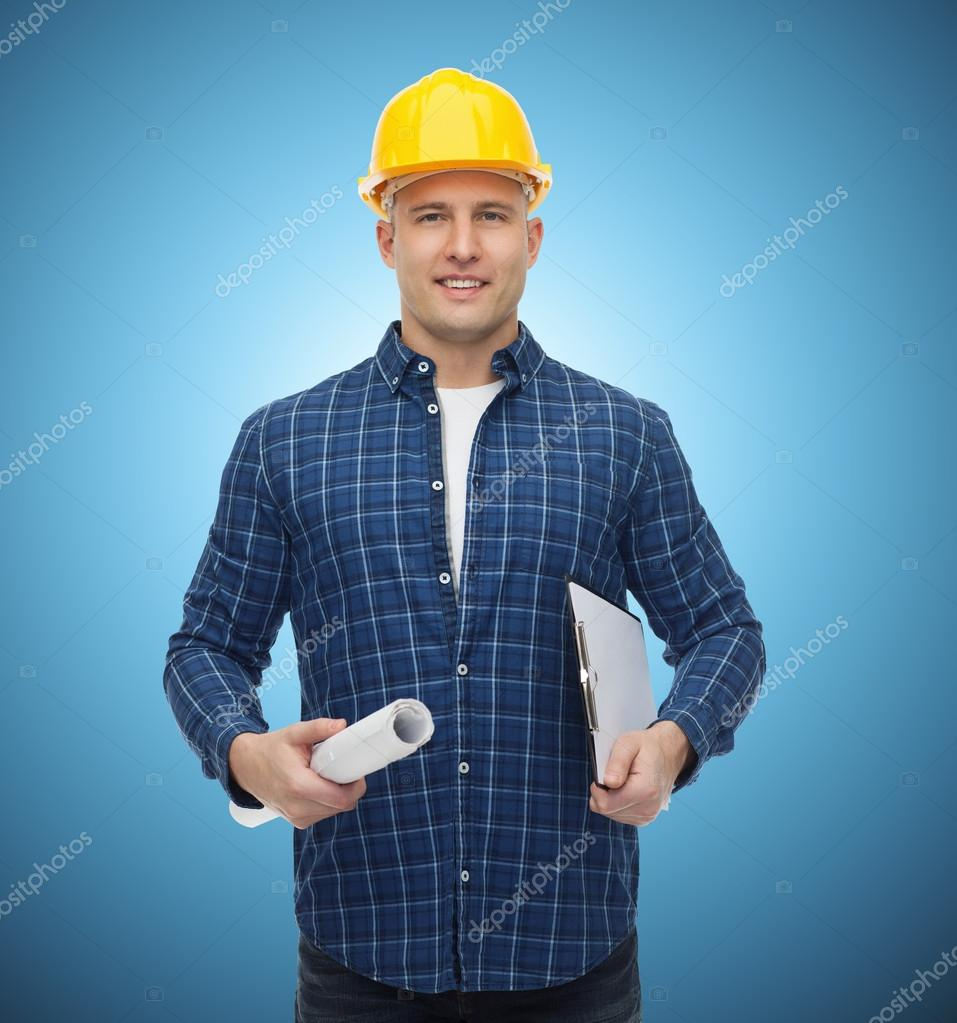 Sonriente hombre constructor en casco con blueprint foto de stock repair construction building people and maintenance concept smiling male builder or manual worker in helmet with blueprint and clipboard over blue malvernweather Image collections