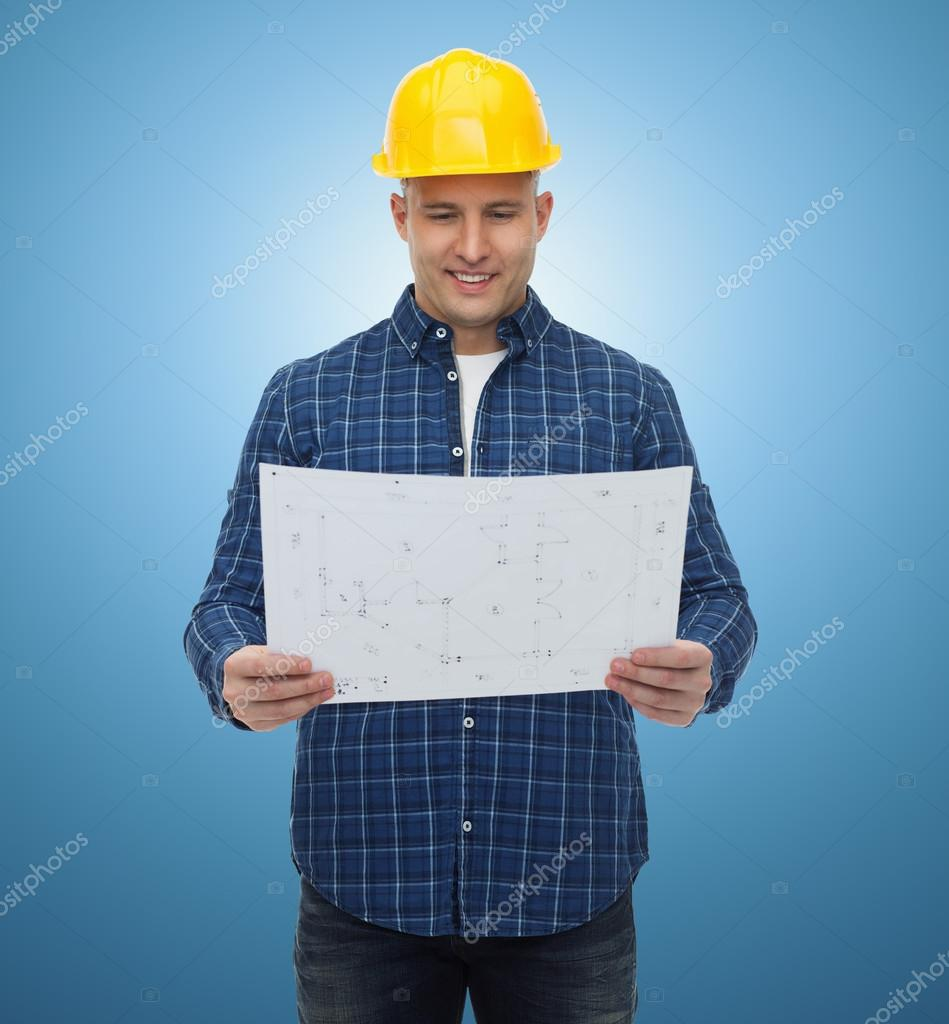 Smiling male builder in helmet with blueprint stock photo repair construction building people and maintenance concept smiling male builder or manual worker in helmet with blueprint over blue background photo malvernweather Choice Image