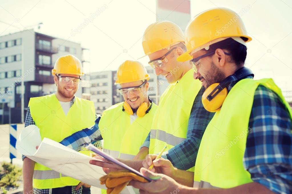 Group of builders with tablet pc and blueprint stock for Building construction types for insurance