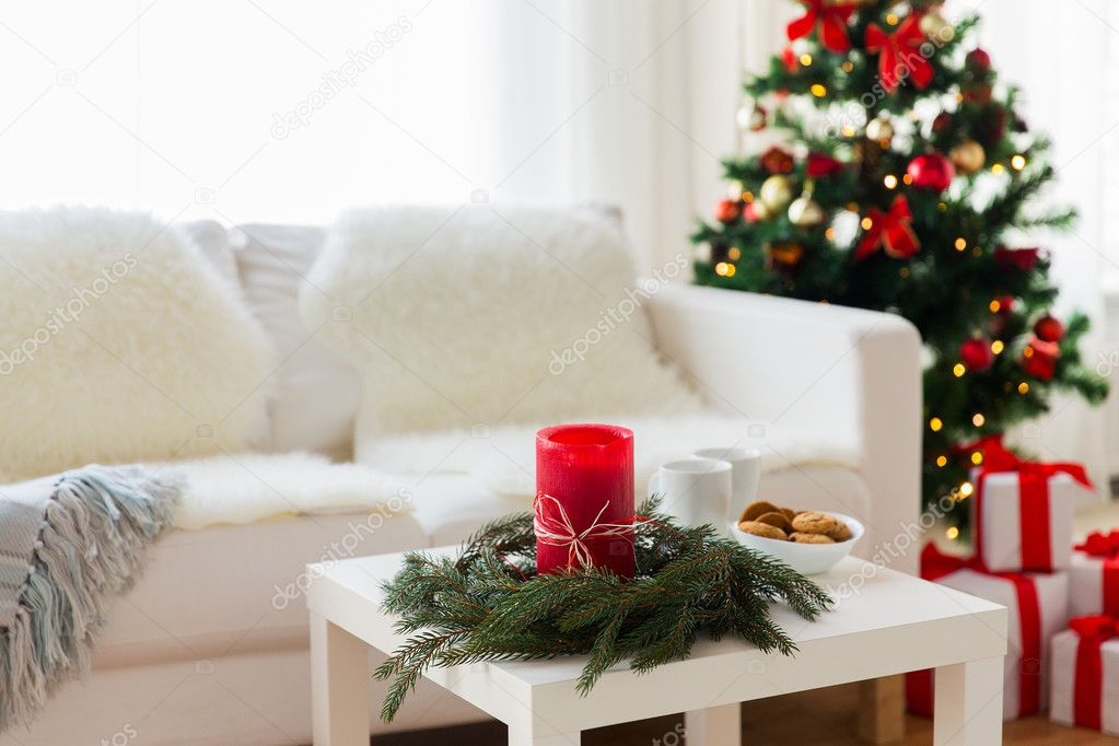 sofa table and christmas tree with gifts at home stock photo - Christmas Decorations For Sofa Table