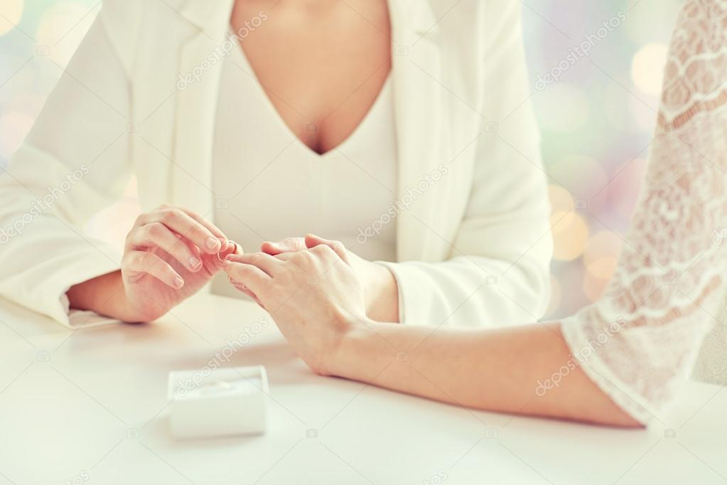 Close up of lesbian couple hands with wedding ring– stock image