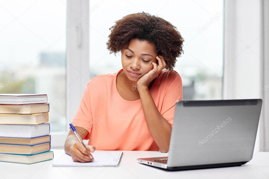 bored african american woman doing homework home — Stock Photo ...